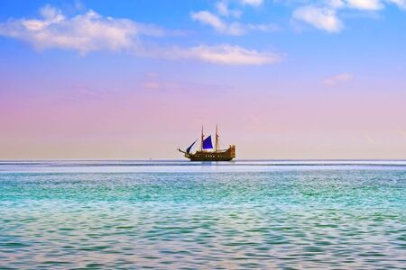 yacht with blue sail in open sea Stock Photo - 4573377