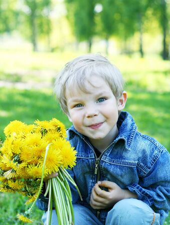Funny kid with dandelions Stock Photo - 4565745