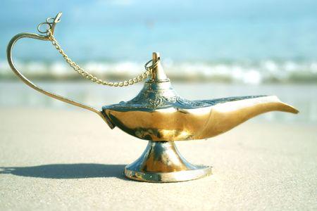 Magic genies lamp on seashor  photo