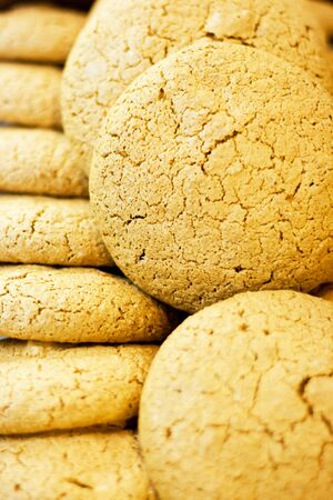 Tasty almond cookies background photo