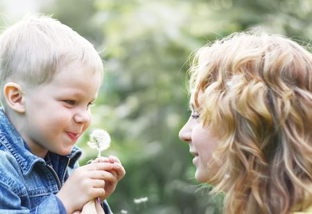 Happy mother with son play on park Stock Photo