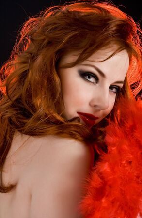 Beautiful sexy redhead woman with red fan Stock Photo - 4613857