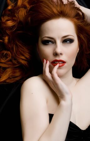 Sexy redhead young woman Stock Photo - 4605090
