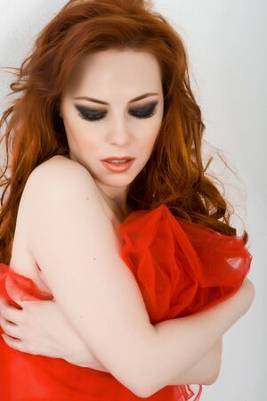 Beautiful redhead woman with red material Stock Photo - 4605214