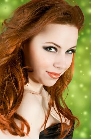 Portrait of beautiful woman on green lighting background photo