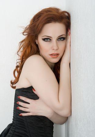 jealous: Beautyful redhead woman with green eyes Stock Photo
