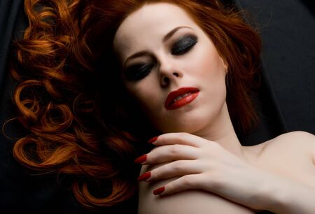Beautiful redhead young woman with scarlet lips Stock Photo - 4605146