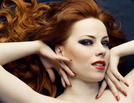 Sexy young woman with red hair Stock Photo - 4605069