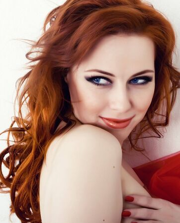 Beautiful young woman with red hair and blue eyes Stock Photo