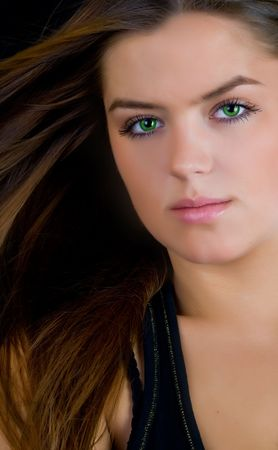 Beautiful woman with mysterius green eyes photo