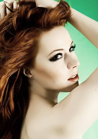 Attractive young woman with red hair Stock Photo
