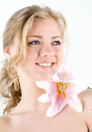 Beautiful smiling young woman with pink lilly Stock Photo - 4880123