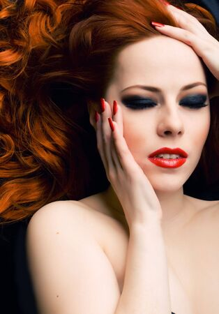 Beautiful young woman with red hair closeup Stock Photo - 4982609