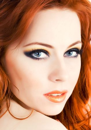Beautiful face of young woman with red hair