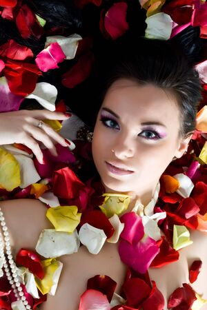 Beautiful young woman in rose petals Stock Photo - 5016743