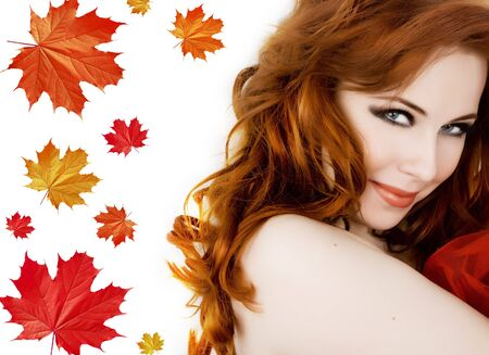 Beautiful young woman with red hair amd maple leaves Stock Photo