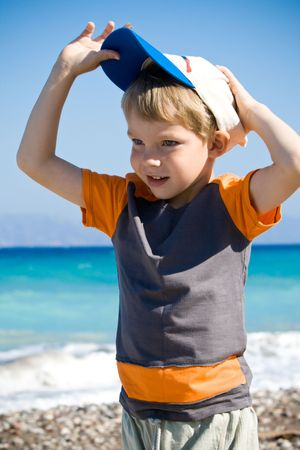 Funny kid with cap in sea beach Stock Photo - 5385036