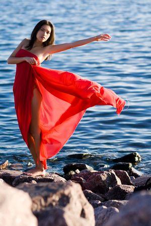 beatitude: Beautiful asian girl with red scarf on seashore
