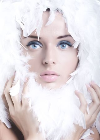 Beautiful young girl with swan feathers Stock Photo - 5559431