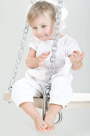 Little beautiful child on swing photo