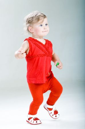 �aucasian: Walking happy child. Studio shoot