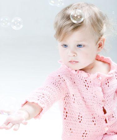 Little child and soap bubbles photo