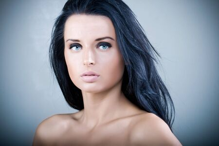 Beautiful young woman with long black hair and blue eyes