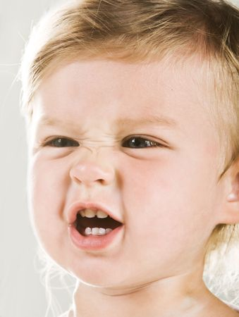 Portrtait of angry baby girl closeup
