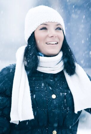 Huppy beautiful smiling girl outdoor with snow photo