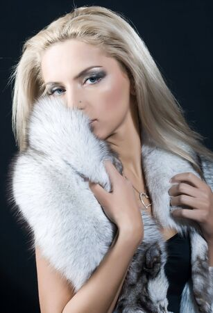Portrait of beautiful young blond woman with blue fox fur Stock Photo - 6462778