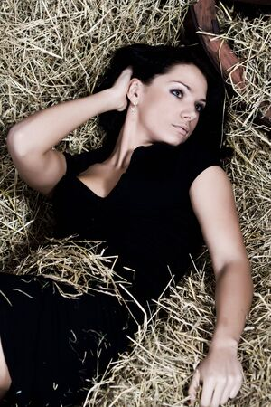 beautiful young woman lie on hay photo