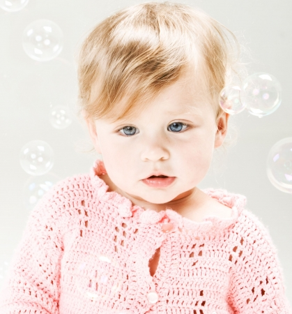 Portrait of very sweet little girl with soap bubbles  photo
