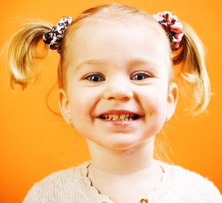 Portrait of very happy little girl