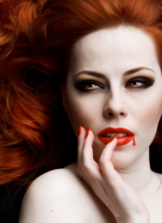Closeup portrait of beautiful redhead vampire woman Stock Photo