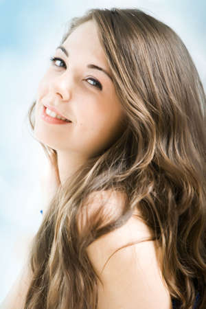 flirtatious: Beautiful smiling young woman with long hair