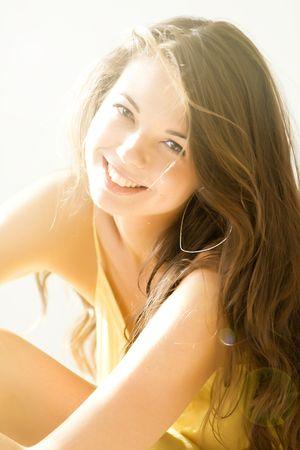 Beautiful young girl luxuriate in sunlight Stock Photo