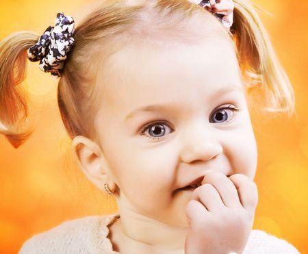 Portrait of happy funny litle girl with ponytails Standard-Bild