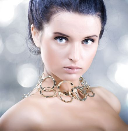 Portrait of beautiful young woman with shiny skin photo