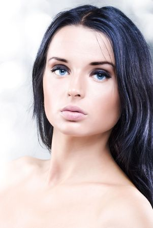 Portrait of beautiful young girl with long black hair