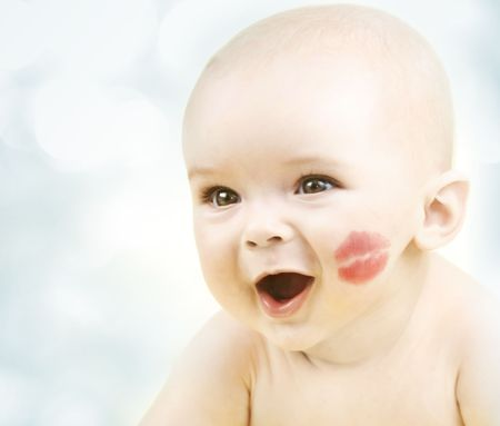 Happy smiling little baby with kiss Stock Photo