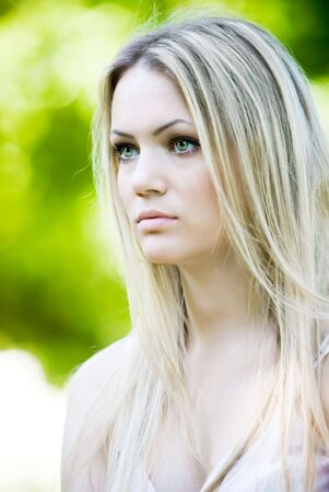 Outdoor portrait of beautiful young girl with long white hair photo