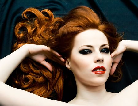 Portrait of beautiful woman with red hair photo