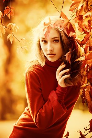 Autumn portrait of beautiful young girl