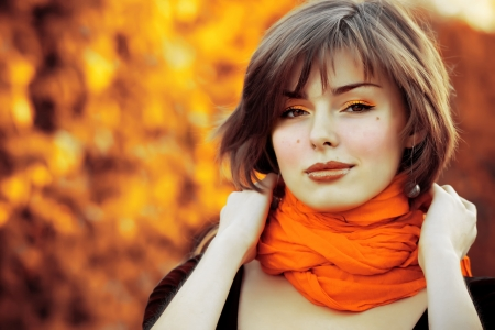 Portrait of very beautiful young woman in autumn park Standard-Bild