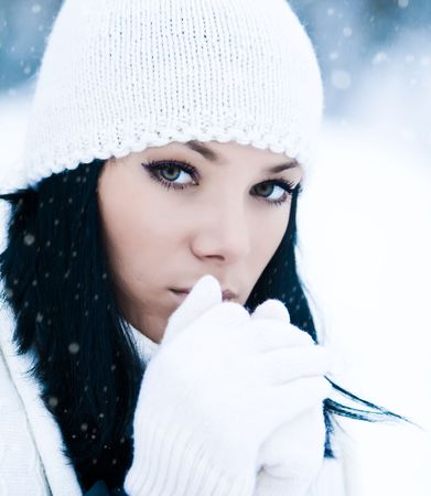 Portrait of beautiful young girl in winter day