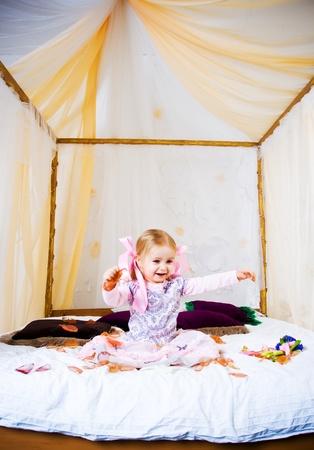 Beautiful little girl play on king bad photo