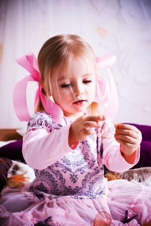 Beautiful little girl in pink dress photo