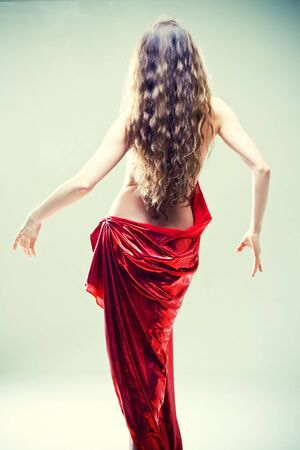 Beautiful undress woman with long curly hair stay back Stock Photo - 8831241