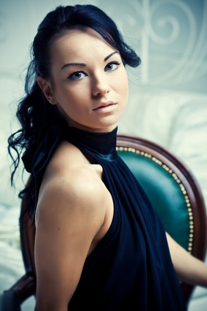 Portrait of beautiful handsome woman in black dress Stock Photo