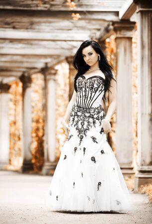 Beautiful young woman in summerhouse photo